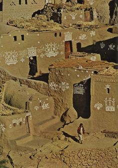 """Nile dwellers build with adobe, as Egyptians did 6,000 years ago. Coptic descendants of the ancient Egyptians inherited their ancestors' technique of making mud brick, and pronounced it """"tobey"""" or """"dobey.""""    Dinner plates decking flood-doomed homes in the Abu Hôr village district may attest the owners' long service in Cairo. Steamboats burst into flower on the wall."""