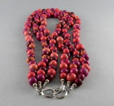 This three strand necklace is about 16 3/8 on the shortest strand and 19 on the longest strand. This is a nice full necklace of blended beautiful colors. Not to heavy because of the Acai seeds are very light. Casual everyday wear... goes with pink, purple, and fuchsia colors. Choose some tagua nut earrings to pull your favorite color out! (earrings sold separately)  Acai beads are seeds from a palm that grows Acai berries, the super fruit, in the Rainforest of South America. They are dye...
