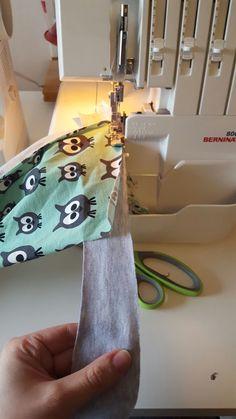 Sy på kantband på tröja manuellt utan bandkantare. | MalinF