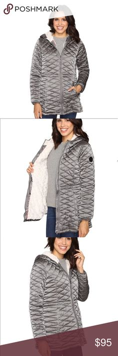 Steve Madden Faux Fur Lined Quilted Puffer Jacket Stylish silver-gray hooded puffer jacket with super soft faux fur lining. Vegan down fill is super warm while still being ultra light-weight and non-bulky. Diamond-quilted material is water and wind resistant to provide extra protection from the elements. Hidden drawstring waist and longer length give this jacket a beautiful hourglass shape. Zip front closure and zippered hand pockets. Machine washable. Stay warm in style with this awesome…