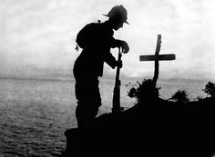 A British soldier pays his respects at the grave of a colleague near Cape Helles, where the Gallipoli landings took place in 1915.