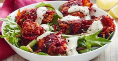 Go meat-free and try these golden carrot and beetroot fritters served with fresh salad leaves, aioli and lemon.
