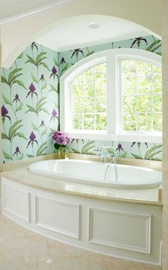 Tub alcove by decorated by Liz Carroll interiors. I generally can't handle wallpaper - it seems claustrophobic to me in almost every way I have seen it used. However, this beautiful bathroom utilizes it in only a small alcove of the room; the rest of the room is painted solid pale neutrals. I think it just MIGHT be working for me...