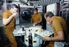 The first Skylab crew enjoys a meal in space.    Part II - Life on Skylab November 9, 2003