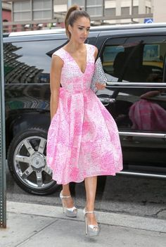 Jessica Alba in a cute pink skater dress and metallic heels