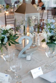 lantern centerpiece - use own colors for flowers and table numbers, etc.