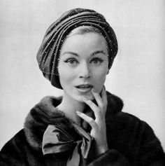 Model in soft turban style cap of sable-colored satin with thin voilette by Gilbert Orcel, mink coat by Max Reby, photo by Pottier, 1957