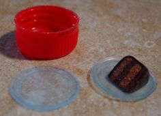 "Miniature Trash to Treasure - The plastic piece from the inside of soda bottles make nice plates.( usually only find these in ""Coca Cola"" products)"