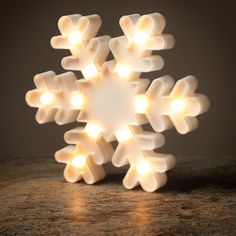 Decorative Christmas LED Light - Snowflake  Add colour and style to your home with our range of LED lights.  Complete with LED lights that require 2 AA batteries (not included), these decorations are perfect for adding that magical touch to your home, garden or special event.