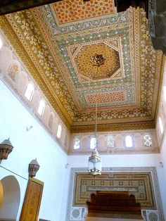 Example of a beautifully painted Moroccan ceiling. Painted on wood panels, with carved panel inserts, the decorative painted ceilings are now done by a very small group of trained artisans in Morocco for mosques, 5 star hotels, and the homes of the wealthy.