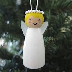 Make this sweet, little wooden angel ornament complete with feather wings for your Christmas tree.