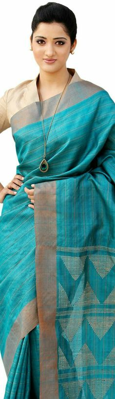 Tusser silk. Very pretty colour for the sari and a modest blouse