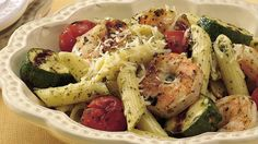 Quick-grilled shrimp and colorful vegetables perk up a simple pasta dinner.