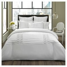 Transform your room's look with a City Scene, Triple Diamond Comforter Set. This sophisticated ensemble effortlessly adds a splash of warmth and classic style to your master or guest bedroom décor. Matching pillow shams complete your new style in a flash. Made from silky-soft polyester fabric for a look and feel you'll love. Snuggle up with this delightful comforter and stay warm and toasty all year long. Set includes comforter and 2 standard pillow shams. Machine washable fo...