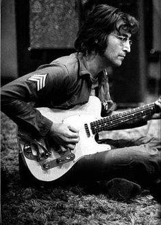 John Lennon and his Telecaster. We miss you John.