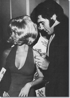 Elvis Presley Press Conference - Las Vegas 1969; signing autographs at the reception.
