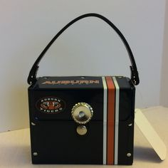 Auburn Handbag Auburn Handbag. Licensed Auburn Petite Handbag. Fleet lined with a bottle cap closure. Has a short recycled rubber handle and a long for cross-body wear. Smoke free home. Bags Crossbody Bags