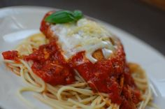 Chicken Parmesan - pounded chicken thin, used egg and milk for batter, added salt pepper and garlic powder to bread crumbs, emeril's marinara and sliced mozzarella, grated Parmesan over garlic and olive oil angel hair