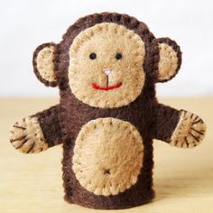 Will this little monkey be apart of Monkey-see, Monkey-do? Curious George? 5 Little Monkeys Jumping on the Bed? Or will the children give him its own little story?    Made from felt, this finger puppet is 2.5 inches tall. Each piece is hand cut and sewn together one tiny stitch at a time. No glue or beads are used.    Would you like to make your own? The pattern for these monkeys can be purchase here: https://www.etsy.com/ca/listing/156091138/pattern-felt-finger-...