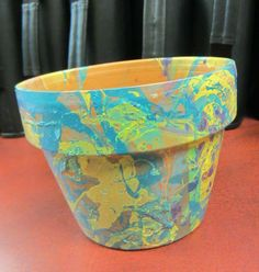 Teens created Marbled Flower Pots using old fingernail polish and water! Here's where we got the idea http://www.henryhappened.com/diy-planters-with-nail-polish.html