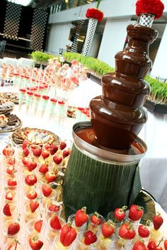chocolate fountain with strawberry fruit musubi looped skewers