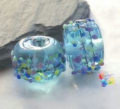 Lampwork Beads Blue Batik Blossom Mix Pair by GlitteringprizeGlass on Etsy https://www.etsy.com/uk/listing/263310671/lampwork-beads-blue-batik-blossom-mix