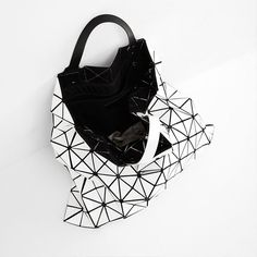 Issey Miyaki's cult #BAOBAO Bag folds and curves to fit the contents of your lifestyle. From white to silver, we have the full collection   Shop www.parlourx.com
