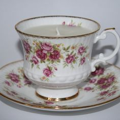 The latest thing in candle making!  I see I'm going to have to do some garage sales and antique bizarres this summer to look for pretty and unique cups.