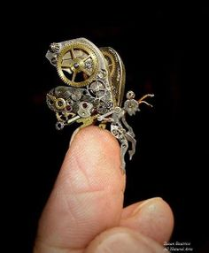 Steampunk faery  Always tinkering with the metal works of cogs and wheels. Fine design!!
