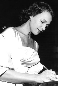 Dorothy Dandridge signing autographs for fans at the premiere of Porgy and Bess, August 1959