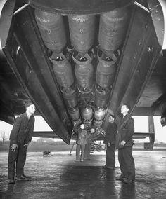 A British ground crew check the bomb load of a Lancaster, 1944.  Frank Scherschel