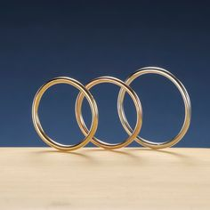 """日輪NICHIRIN   天空に 円虹の光 誓いし絆  美しい日の出をイメージしました。筒型のアームがぐるりと指をくるみます。太陽の光線がまろやかな光となってこだわりの「○」を作り上げました NICHIRIN   Light oath ties circle rainbow in the sky   I have the image of a beautiful sunrise. Cylindrical arm will walnut the round finger. I have created a """"○"""" commitment rays of the sun becomes a mellow light"""