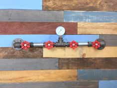 A personal favorite from my Etsy shop https://www.etsy.com/listing/268818059/industrial-coat-rack-industrial