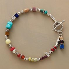 """CARAVANSARY BRACELET--Sterling beads and charms mingle with colorful gems, including coral, turquoise, garnet, carnelian, lapis, tigereye, jasper, rhodonite and peridot. Sterling silver toggle clasp. Handcrafted in USA exclusively for Sundance. 7-1/2""""L."""