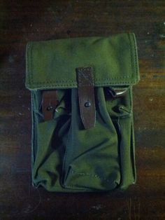 Heavy canvas pouch with leather closures