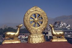 Roof of Jokhang Temple, Potala Palace in the distance, Lhasa, Tibet