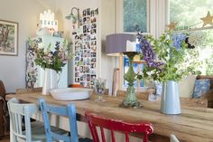 cottage, shabby chic, rustic, bright white walls, farmhouse dining room kitchen mismatched, painted chairs
