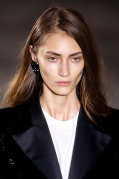 At Saint Laurent, the trend towards natural looking make-up continued. Highlighter was used along the forehead and cheekbones, with a highly glossy sheen under the eyes as well, which emphasised the models' bone structure without the skin appearing to have been overly worked or weighed down. Brows were left natural but brushed upwards slightly using an eyebrow brush to create a little volume – use Benefit's Goof Proof Eyebrow Pencil, £18.50, to darken yours if required. The look was…