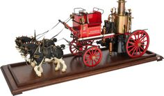 LIVE STEAM SCALE MODEL HISTORIC DUTCH FIRE APPARATUS  15-1/2 x 35 x 10 inches (39.4 x 88.9 x 25.4 cm  Finely engineered and authentically detailed 1.6 scale model of a horse-drawn 1901 Dutch fire pumper, with brass fittings and including hoses and team of horses. Livery of Brandweer Wormeveer, Rotterdam 1901.