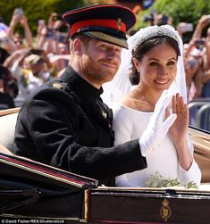 Prince Harry and Meghan Markle passed by the crowds in the royal carriage procession