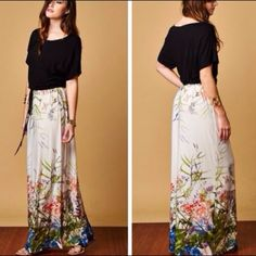 Floral Maxi Dress❗️Last One❗️ Gorgeous flowing maxi dress with floral pattern on the bottom and solid black top.  Cinches in at waist and ties.  Medium bust measures 38 inches, waist 32 length from shoulder 59 inches.  Large bust 42 inches, waist 36 inches, length 50 inches.  Material is 95% rayon and 5% spandex.  Lowest prices upfront. Dresses Maxi