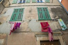 Laundry hanging off windows in Menton on the French Riviera. Photo: Sivan Askayo