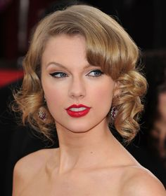 Before chopping her long hair in early 2014, Taylor Swift flirted with a short 'do by under-pinning her curls — a wispier, more playful version of the classic 20s look.