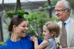 kungahuset.se:  July 7, 2014-The Swedish Royal Court has released photos taken in early summer 2014 at Skansen, the Swedish open air museum-Crown Princess Victoria with a bird on her head as Princess Estelle and King Carl Gustaf look on