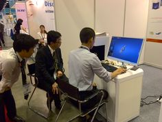Our colleague is showing how to use UPCAD dental design software to Japan customers