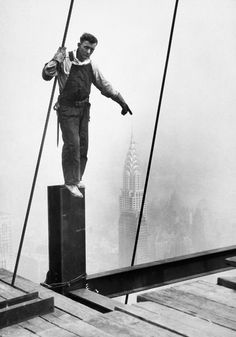 """""""Steelworker touching the tip of the Chrysler Building"""" :: NYC, NY 1931 :: Photographer Lewis Hine."""