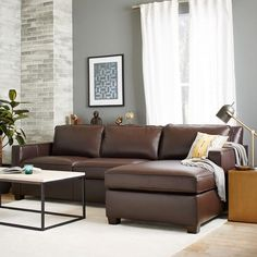 Leather's new look. Our popular upholstered Henry Sectional also comes in rich, top-grain leather.