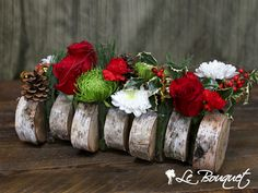 We put our own on the beloved and traditional log! Staying true to we salvaged fallen trees & filled them with an assortment of extras and red, green and white This rustic yet classic arrangement makes for a lovely and even better centerpiece! Christmas Log, St Laurent, Bouquet, Birch Trees, Holiday Tables, Floral Centerpieces, Christmas Traditions, Montreal, White Flowers
