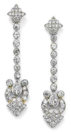 Lot 273, à pair of art déco diamond ear pendants