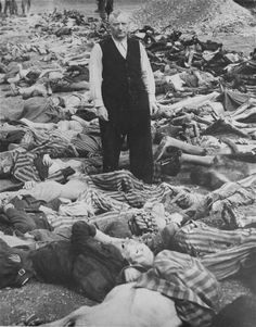 SS officer Johann Baptist Eichelsdoerfer, the commandant of the Kaufering IV Concentration Camp (Hurlach, Bavaria, Germany, stands among the corpses of prisoners killed in his camp.  Date: Circa April 27 - April 301945